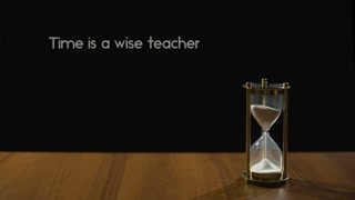 time-is-wise-teacher-popular-expression-about-experience-hourglass-on-table_rezgpj-adx_thumbnail-small09