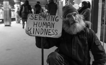 beggar seeking human kindness