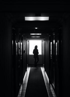 Person in dark hall
